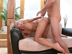 Blond Lola satisfies mans sexual needs and desires and then gets her lovely face covered in man goo