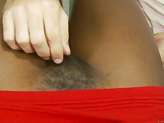 Sexy ebony Ana Foxxx in red mini suit shows her hairy snatch to a white dude. This guy plays with her bush and then she spread her legs wide to give his stiff dick a try. She is hungry for sex