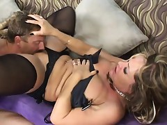 Sexy blond cougar in black lingerie receives fucked hard by a young stud