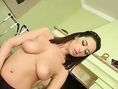 Striking brunette with large boobs Daria fingers her peach to pleasure