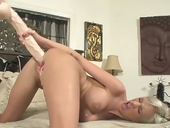 Blonde plays with sex toy