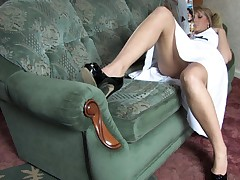 Enchanting blonde shows her goods upskirt down blouse style